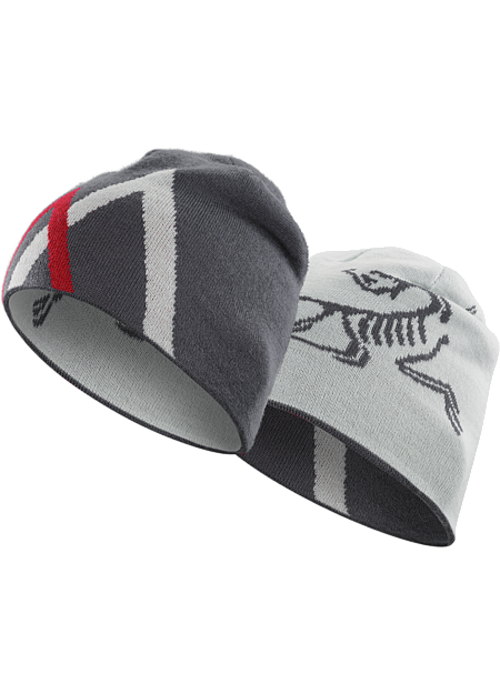 Close fitting wool blend reversible toque with a bold Arc'teryx bird logo on one side, stylized mountain graphic on the other.