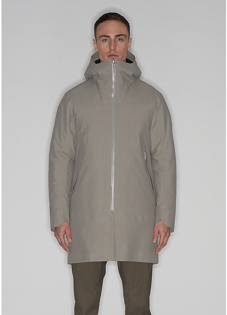 Down insulated, thigh-length coat with ample storage and an adjustable storm hood.