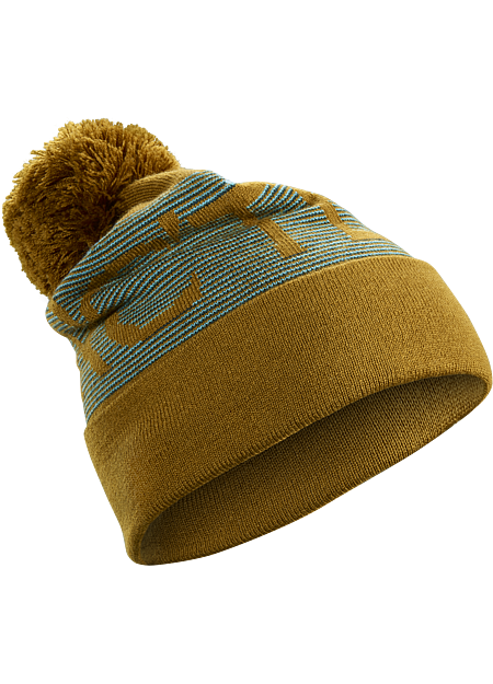 Warm winter hat with Arc'teryx word logo, a band of stripes and a fluffy pom.