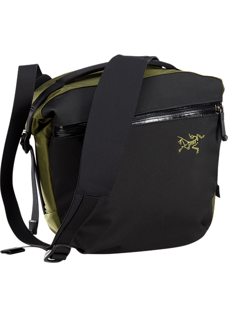 Urban commuter shoulder bag with functional organization.
