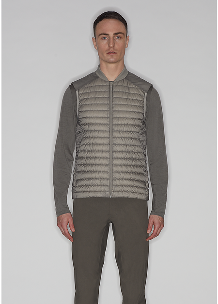 Lightweight down vest that can be worn alone or beneath a jacket for additional warmth.