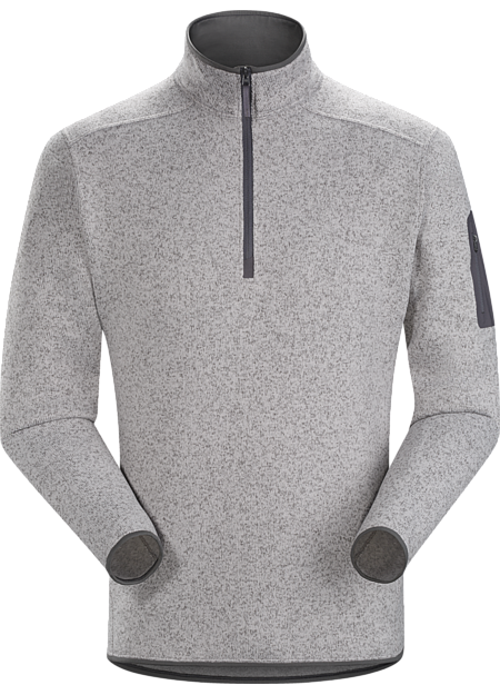 Clean, casual lines and technical performance fleece combine in a 1/2 zip pullover with wool sweater styling.