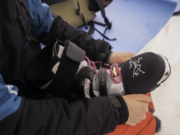 Brylee putting toe cap on ski boot