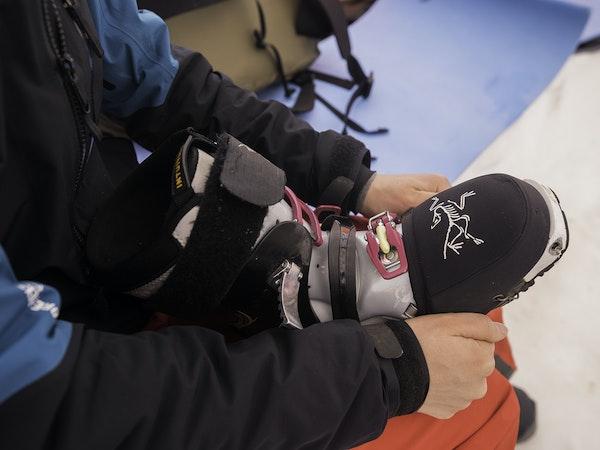 Brylee putting toe cap on ski boot