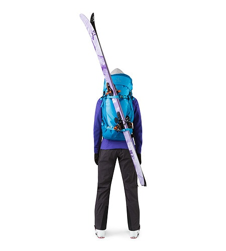 Khamski 31 Backpack Ionian Blue Skis Attached Diagonally